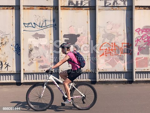 istock Pedestrian goes Graffiti wall background 666091444