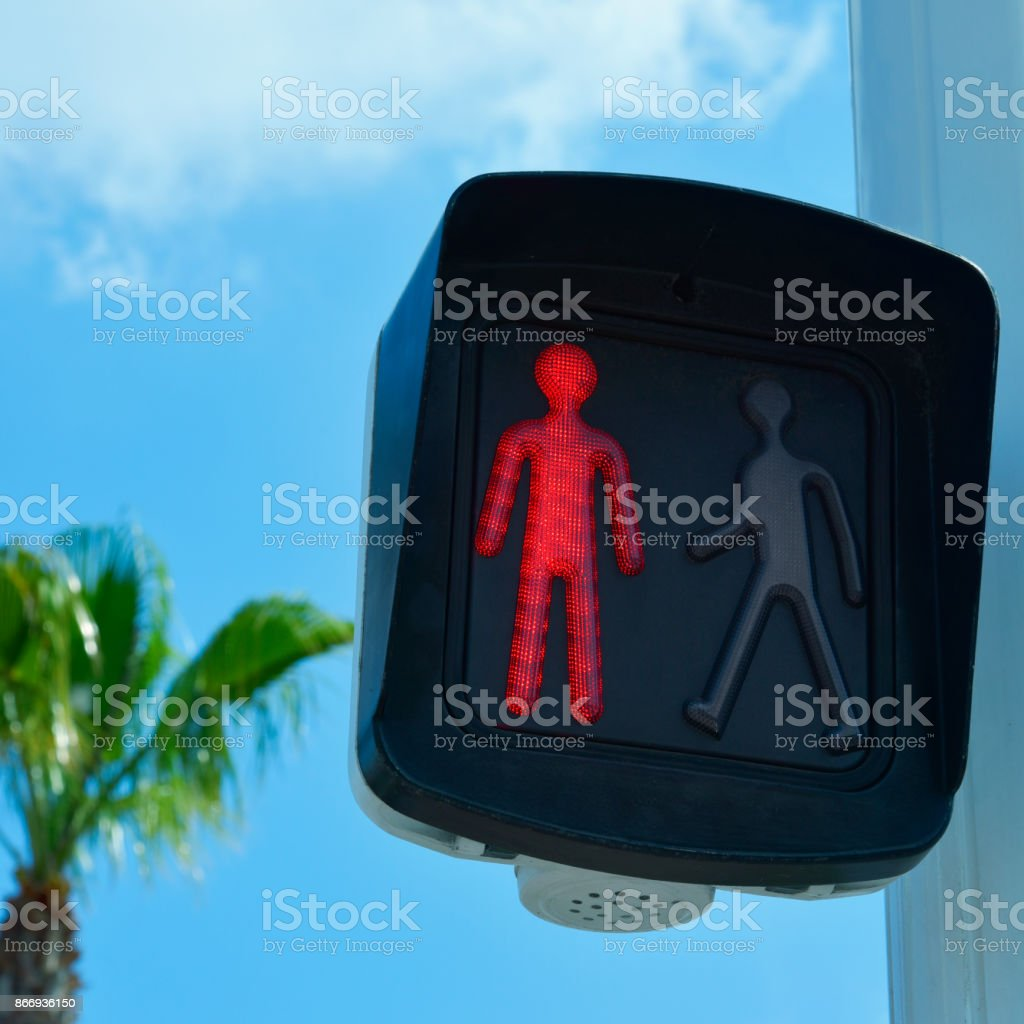 pedestrian light with a red man stock photo