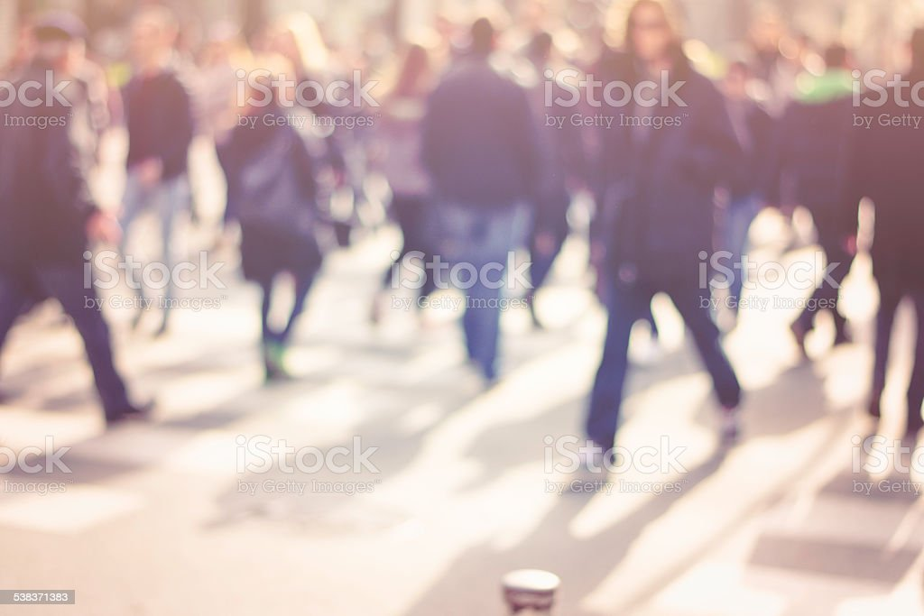 pedestrian on zebra in motion blur stock photo