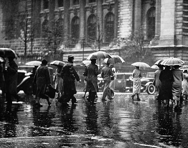 Pedestrian passing street, rainy weather, New York, USA (B&W)  20th century history stock pictures, royalty-free photos & images