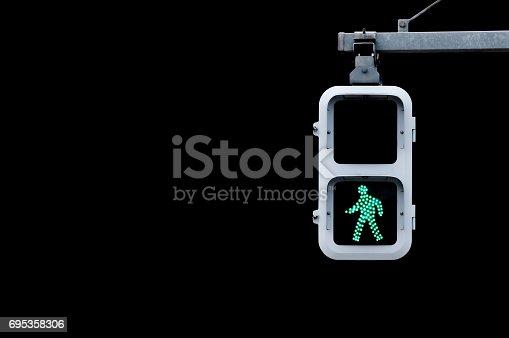 Japanese pedestrian signal isolated on Black.