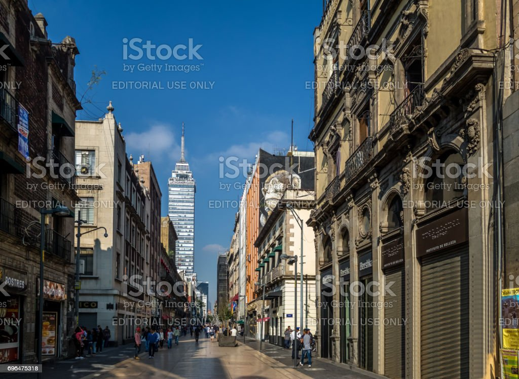 Pedestrian street in Mexico City downtown with Latinoamericana Tower...