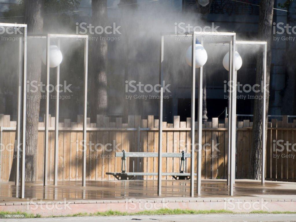 Pedestrian street sprinklers stock photo
