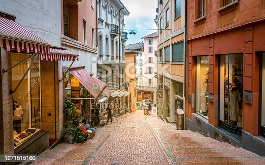 Lugano Switzerland , 1 July 2020 : Pedestrian Via Cattedrale sloped shopping street of Lugano with colorful houses in Ticino Switzerland