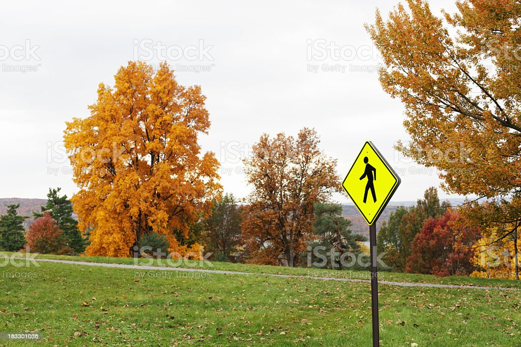 Pedestrian Walking Sign Near Autumn Nature Footpath stock photo