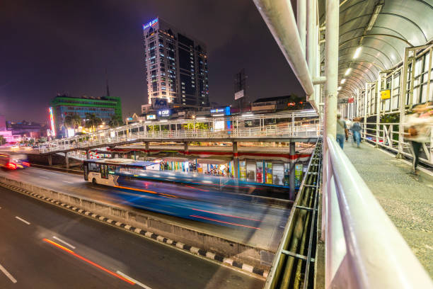 Pedestrian Walkway Flyover in Bus Rapid Transit Station, Jakarta, Indonesia Jakarta, Indonesia - August 20, 2018: view showing Jakarta City street and pedestrian way flyover in Bus Rapid Transit station at night bus rapid transit stock pictures, royalty-free photos & images