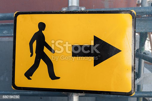istock Pedestrians bypass direction. Yellow road sign 530194230