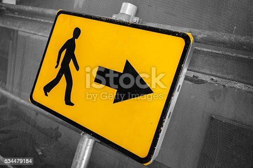 istock Pedestrians bypass direction. Yellow road sign 534479184