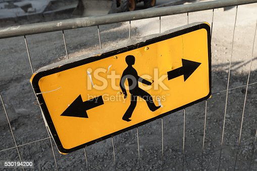 istock Pedestrians bypass directions. Yellow road sign 530194200