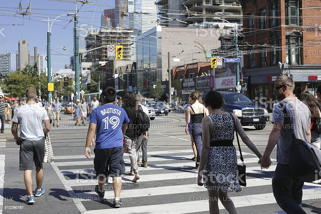 Pedestrians Cross Intersection at Spadina Avenue and Queen Street, Toronto stock photo