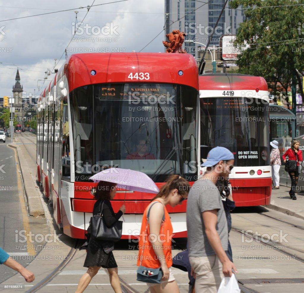 Pedestrians Cross Toronto's Spadina Avenue in Chinatown stock photo