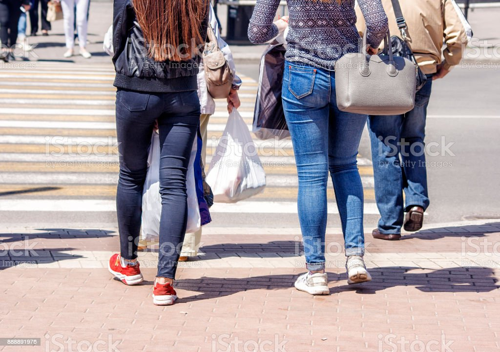 pedestrians crossing a street in the city stock photo