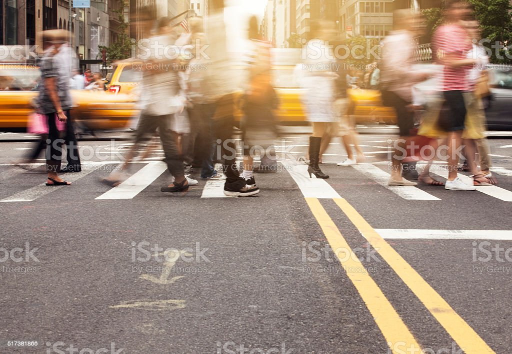 Pedestrians crossing at intersection, New York City stock photo