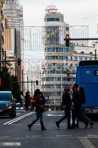 Madrid, Spain - November 1st, 2020: Pedestrianscrossing Calle Gran Via street in Madrid, Spain the most important commerical street