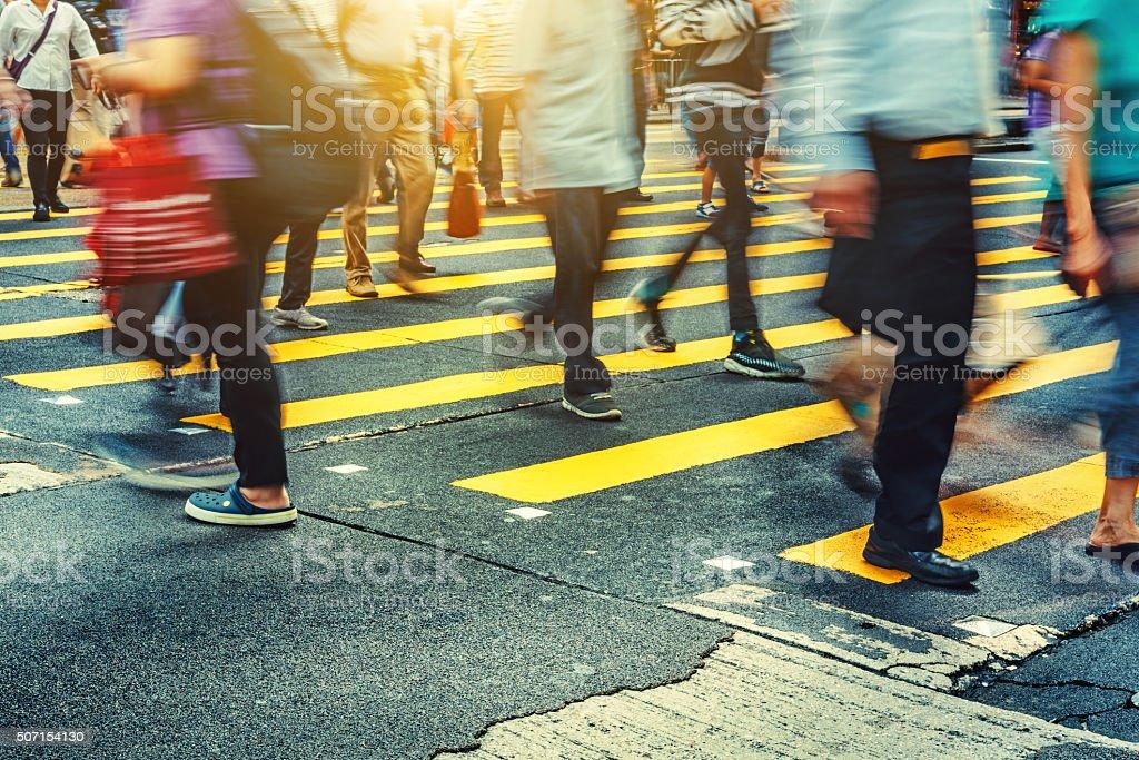Pedestrians crossing Road in  Hong Kong stock photo