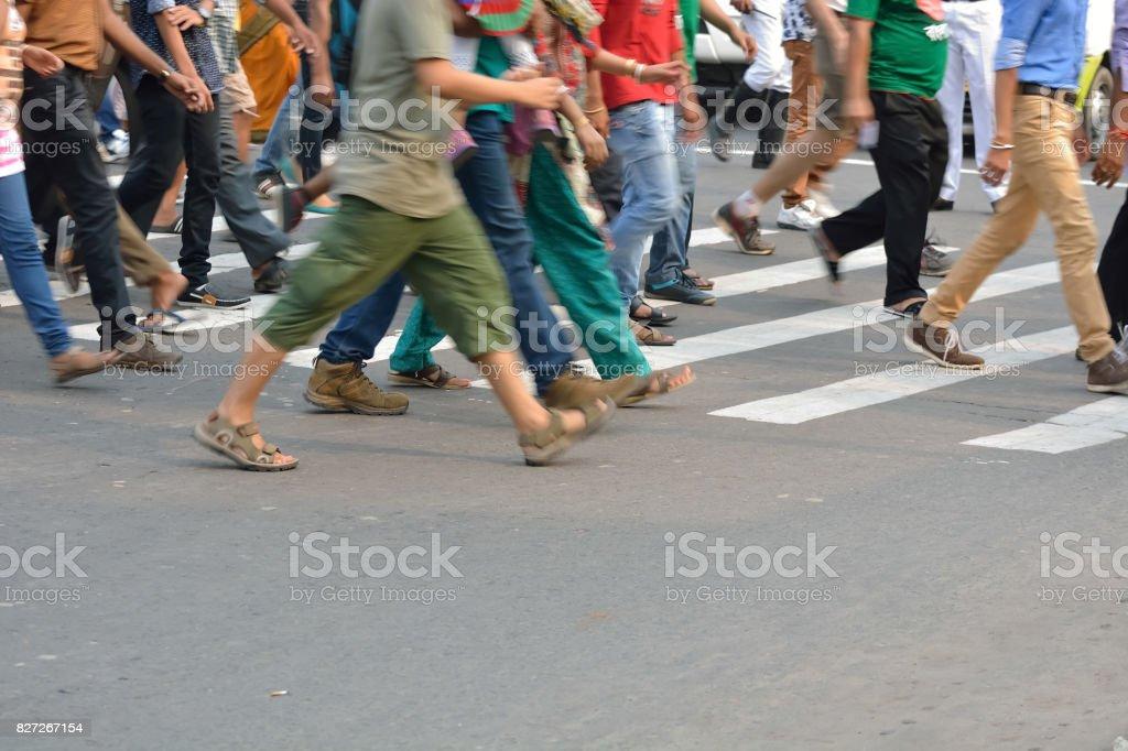 Pedestrians crossing road stock photo