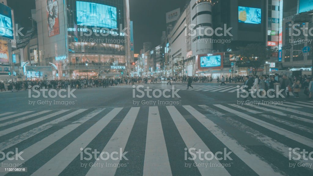 Pedestrians crossing street at Shibuya intersection Aerial View Tokyo...