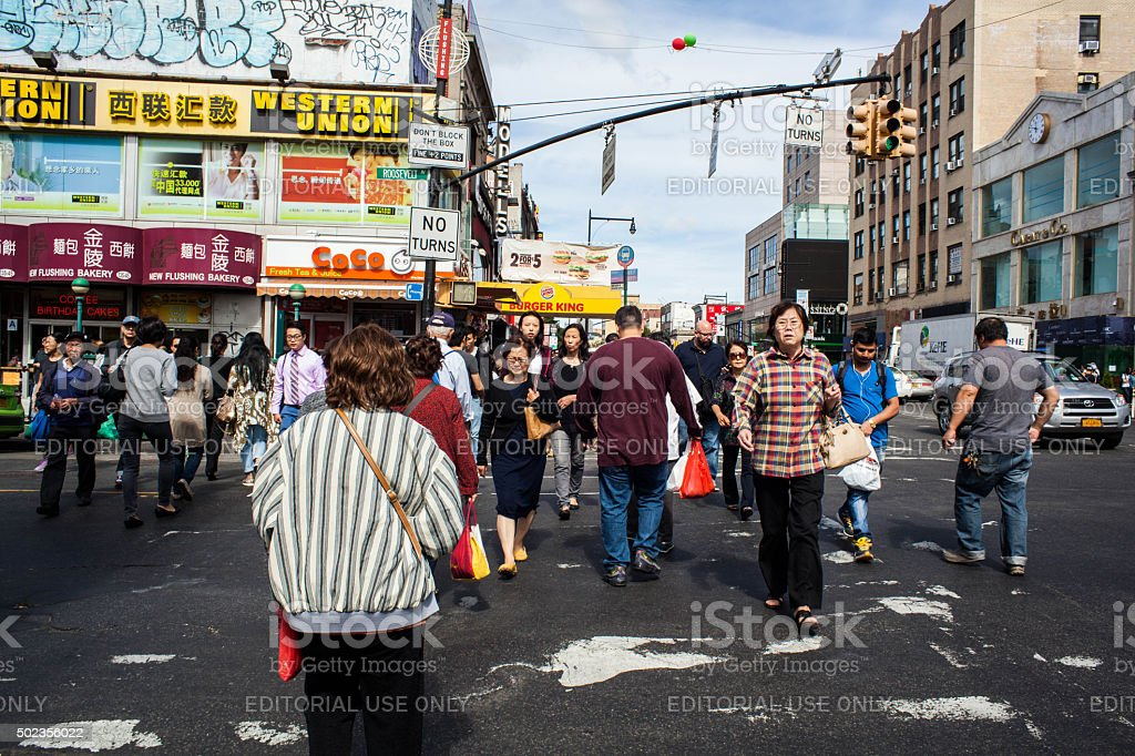 Pedestrians crossing the street Flushing Queens' Chinatown stock photo