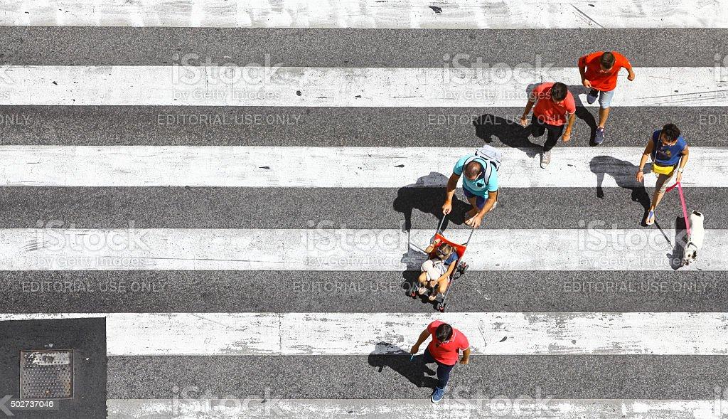 Pedestrians crossing the street stock photo