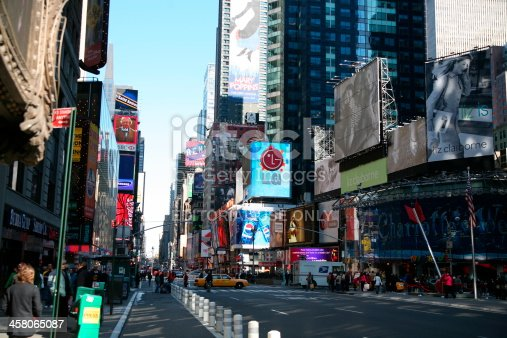 1202686823istockphoto Pedestrians in Times Square 458065087