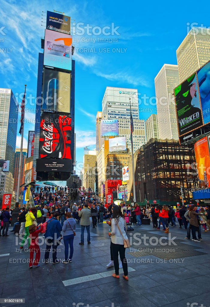 Pedestrians on 7th Avenue and Broadway in Times Square USA stock photo