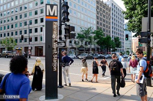 Washington DC, USA - June 15, 2012: Pedestrians on the move outside the Farragut West metro station in downtown Washington DC.