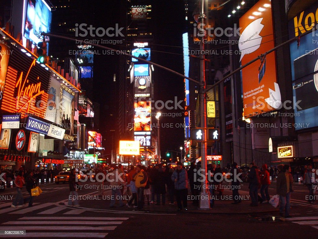 Pedestrians on Times Square in Manhattan at Night. stock photo