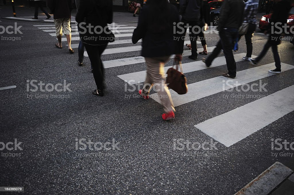 Pedestrians on zebra crossing by night royalty-free stock photo