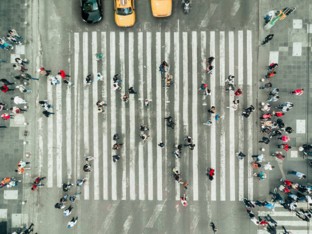 Pedestrians on zebra crossing, New York City Pedestrians on zebra crossing, New York City drone point of view stock pictures, royalty-free photos & images