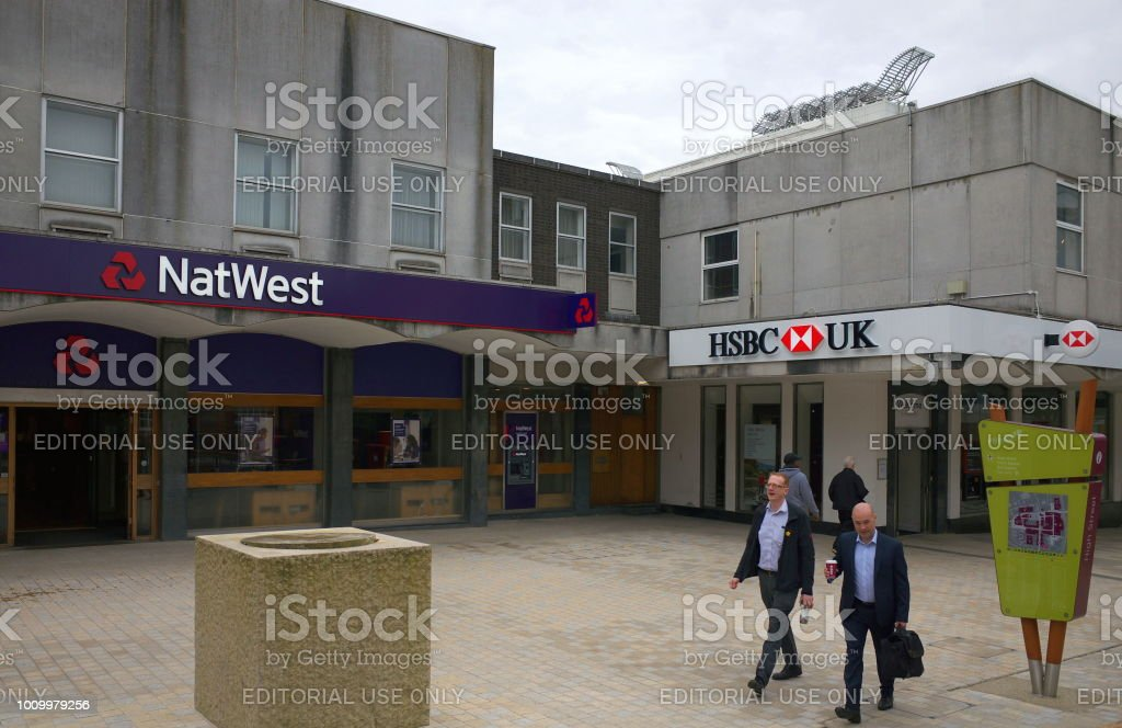 Bracknell, England - April 17, 2018: Pedestrians passing by adjoining branches of the National Westminster and HSBC banks in the High Street of Bracknell, England stock photo