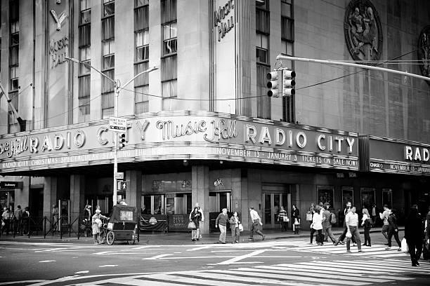 Pedestrians walk By Radio City Music Hall New York stock photo