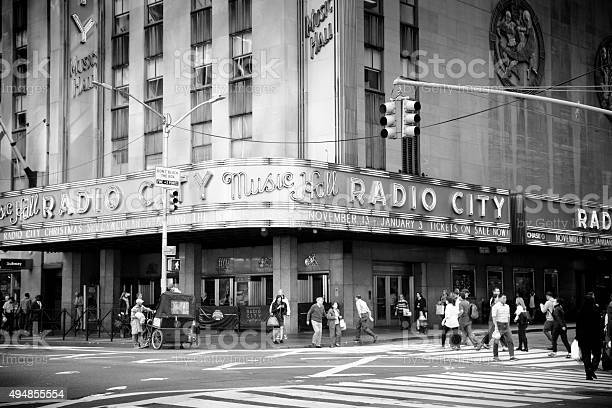 Pedestrians Walk By Radio City Music Hall New York Stock Photo - Download Image Now