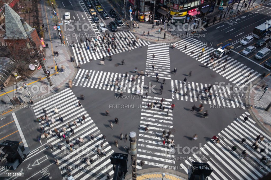 Tokyo, Japan - 22 February 2019 - Pedestrians walk crossing street...