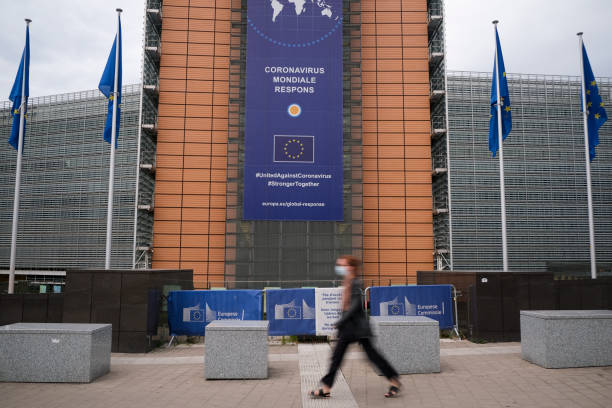 Pedestrians walk in front of the European Commission headquarters Pedestrians walk in front of the European Commission headquarters in Brussels, Belgium, 12 June 2020 european commission stock pictures, royalty-free photos & images