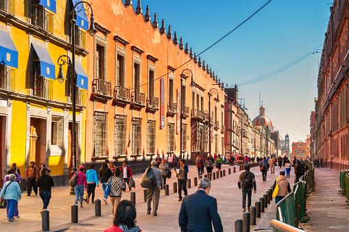 Pedestrians walk on Calle Moneda at Zocalo Downtown Mexico City