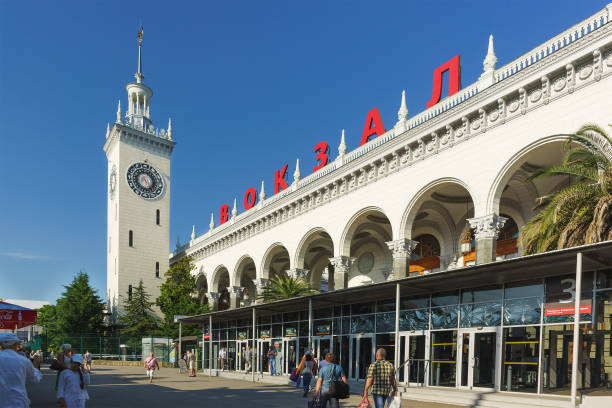 Pedestrians walk past the train station Sochi Sochi, Krasnodar Krai, Russia - June 09.2017: Pedestrians walk past the train station Sochi sochi stock pictures, royalty-free photos & images