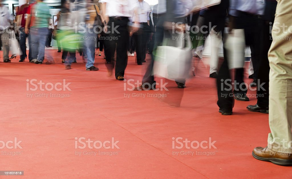 Pedestrians walking on a red carpet stock photo