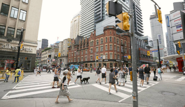 Pedestrians Walking on Yonge Street at College Street, Toronto stock photo