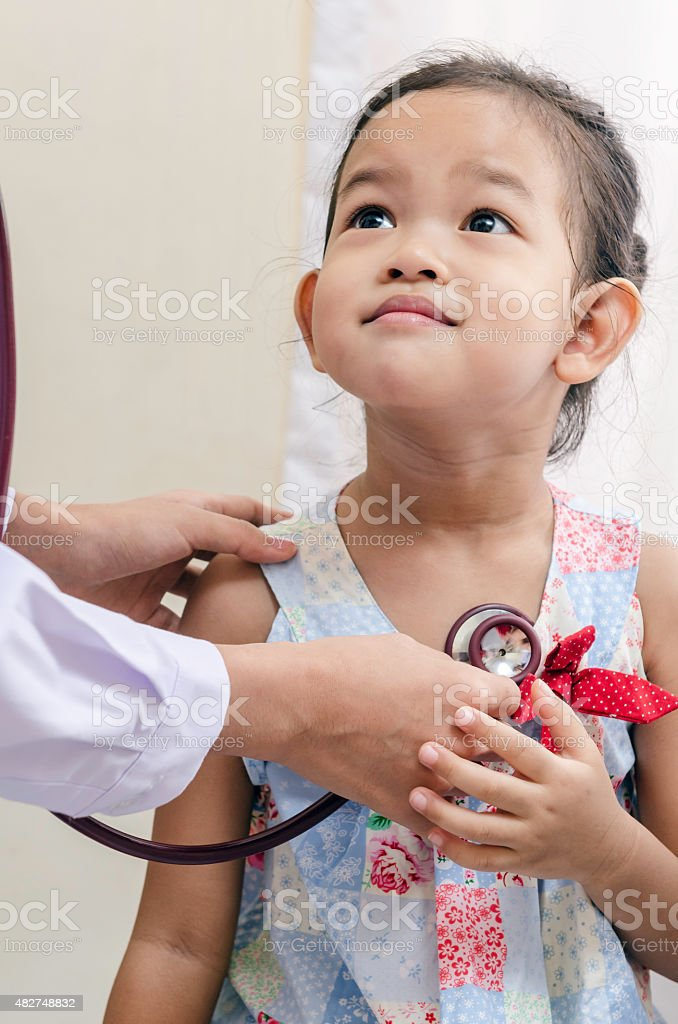 pediatrician and a child stock photo
