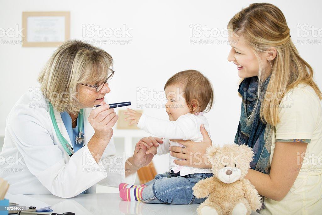 Pediatrician Checking Eyesight of an baby girl. royalty-free stock photo