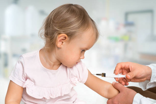 Pediatrician doctor is injecting vaccine to shoulder of baby Pediatrician doctor is injecting vaccine to shoulder of baby - vaccination concept measles stock pictures, royalty-free photos & images