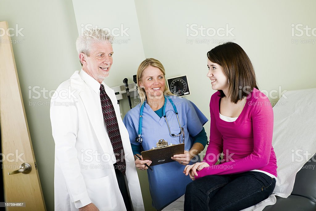 Pediatrician, Nurse and Patient royalty-free stock photo