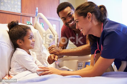istock Pediatrician Visiting Father And Child In Hospital Bed 504458834