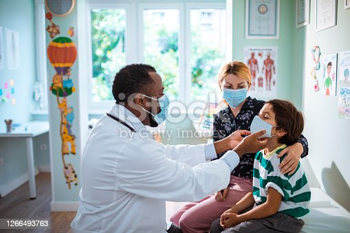Close up of a pediatrician having a check up on his patient