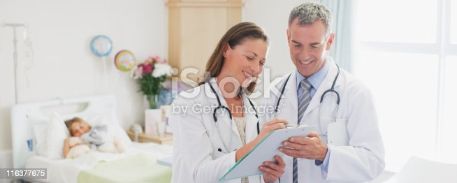 istock Pediatricians reviewing patients medical record in hospital 116377675