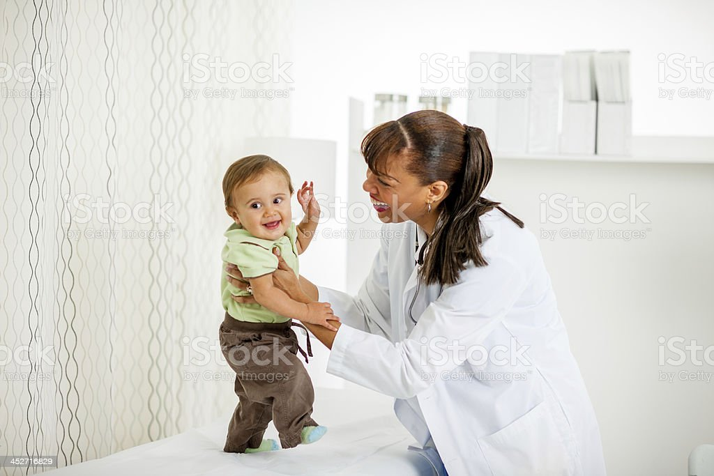 Pediatrition with baby boy stock photo