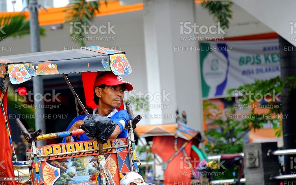 Pedicab Driver resting stock photo