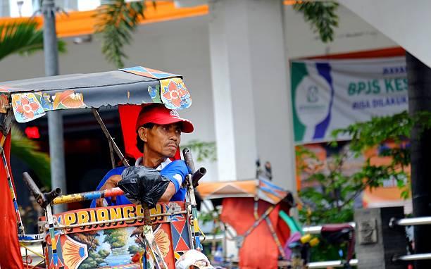 Pedicab Driver resting stock photo