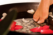 Beautiful foot dipping into relaxation.