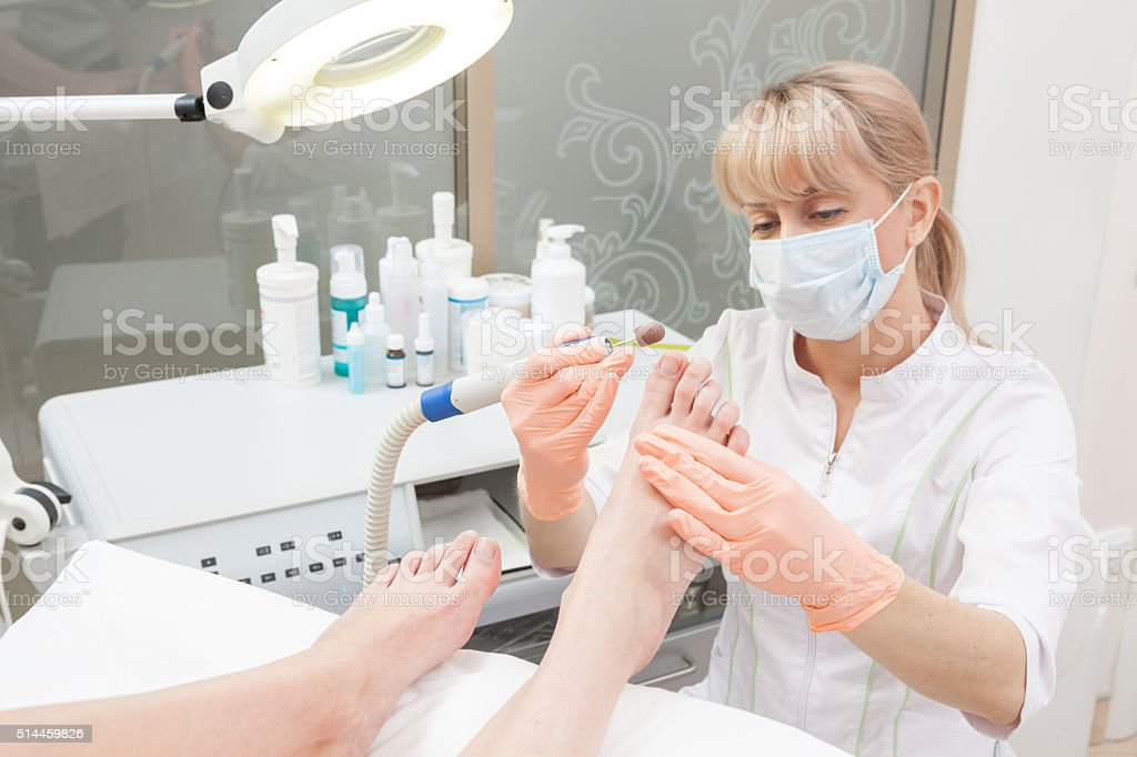 Pedicure in a Day Spa, feet nails stock photo